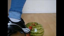 Jana crushes a watermelon with her Adidas soccer shoes trailer