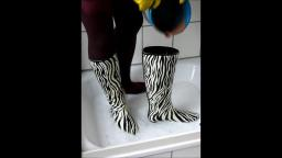 Jana write on fill and messy her zebra rubber boots in the shower trailer
