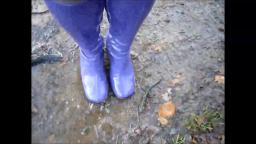 Jana walks with her shiny purple gogo boots in the forest puddle and mud trailer