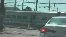 LIRR TRAIN PASSING LONG BEACH ROAD IN ISLAND PARK