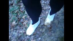 Jana walks in mud and puddles with her shiny white Chelsea rubber ankle boots trailer