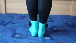 Jana shows her glow in the dark shiny rubber booties turquoise with black loop