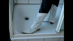 Jana fill and messy her white heel cowgirl boots in shower trailer