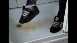 Jana crushes a pumpkin with her shiny black Adidas Superstars and washes them in the shower trailer