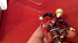 little boy opens a shulk toy