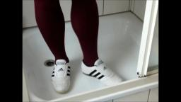 Jana write on squeaks with her Adidas Martial Arts white black and destroy them in shower trailer