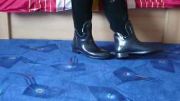 Jana shows her black Romika rubber boots with rear zipper