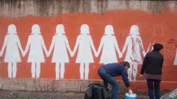 Restoring an anti-femicide mural in Rome, Italy