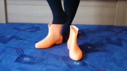Jana shows her glow in the dark shiny rubber booties orange with black loop