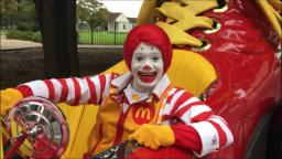 Ronald Mcdonald goes for a joy ride in his giant clown shoe car