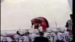 hockey player tries to start fight, slips