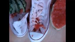 Jana crushes a watermelon with her white Converse Chucks and messy them with it close up trailer