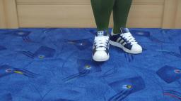 Jana shows her Adidas Superstar shiny blue with white stripes