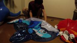 Riding and Deflating an Inflatable Dolphin